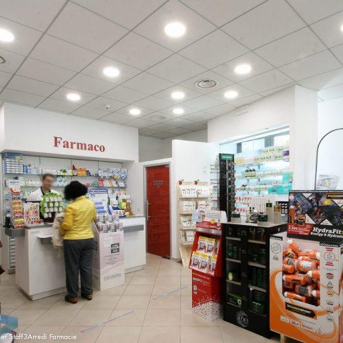 Vista Interna Farmacia Con Bancone Bianco